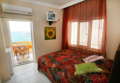 Holiday rooms air-conditioned with 1 double bed each, capable for 2 persons, shower bath wc, satellite-tv, air conditioning.